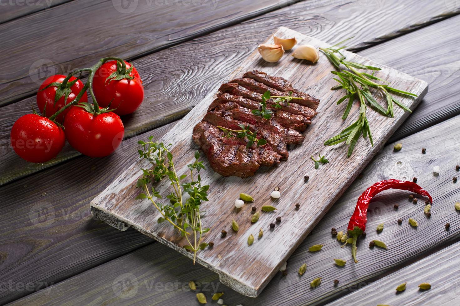 Delicious beef steak with tomato. photo