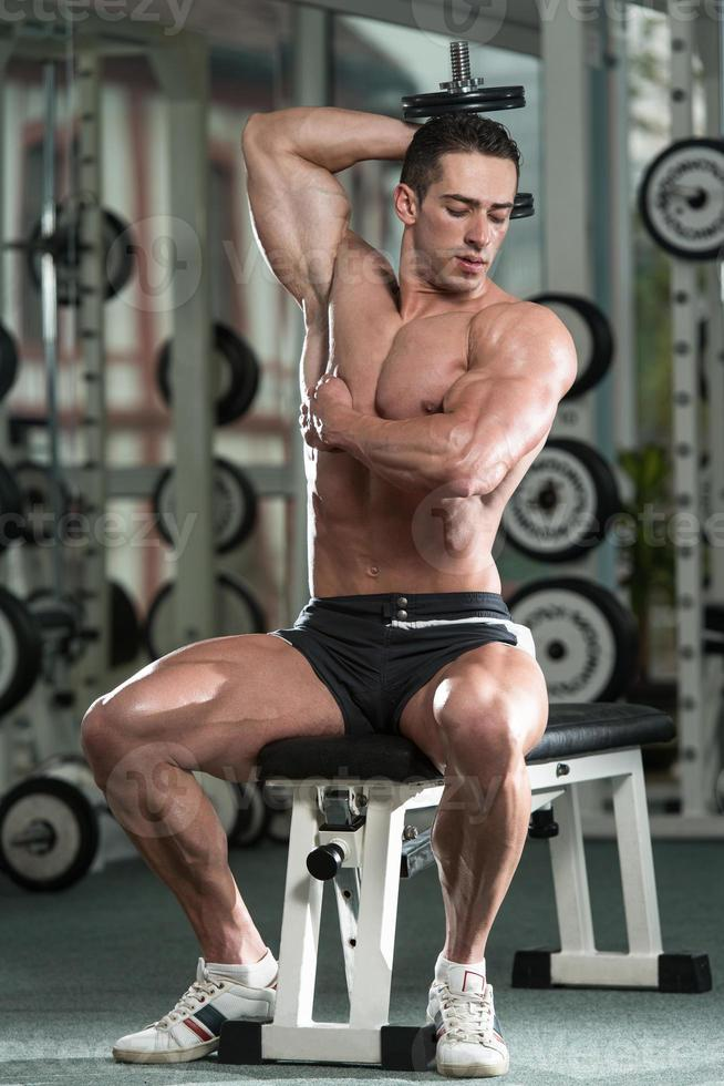 Young Man Working Out Triceps photo