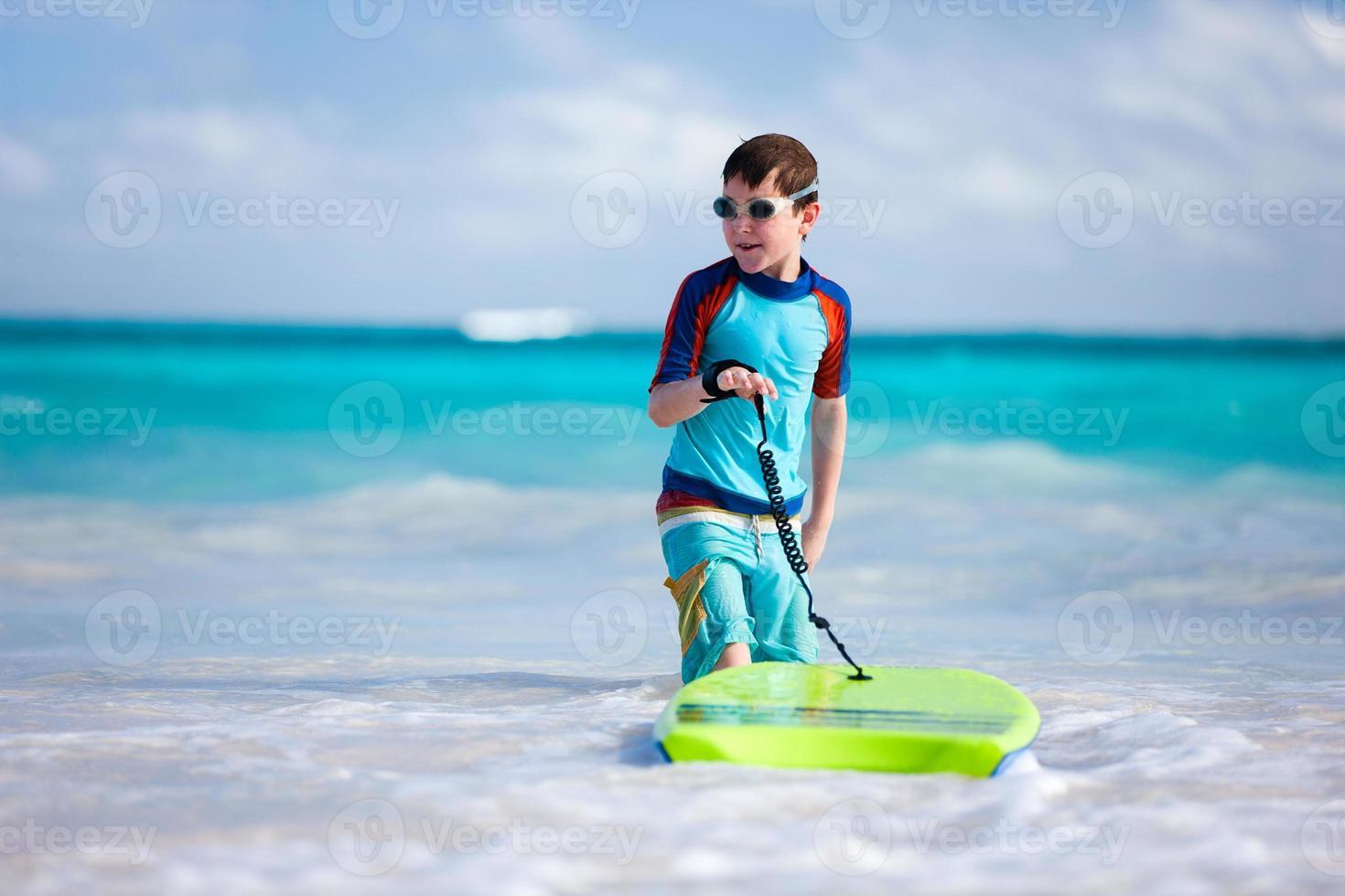 Boy surfing photo