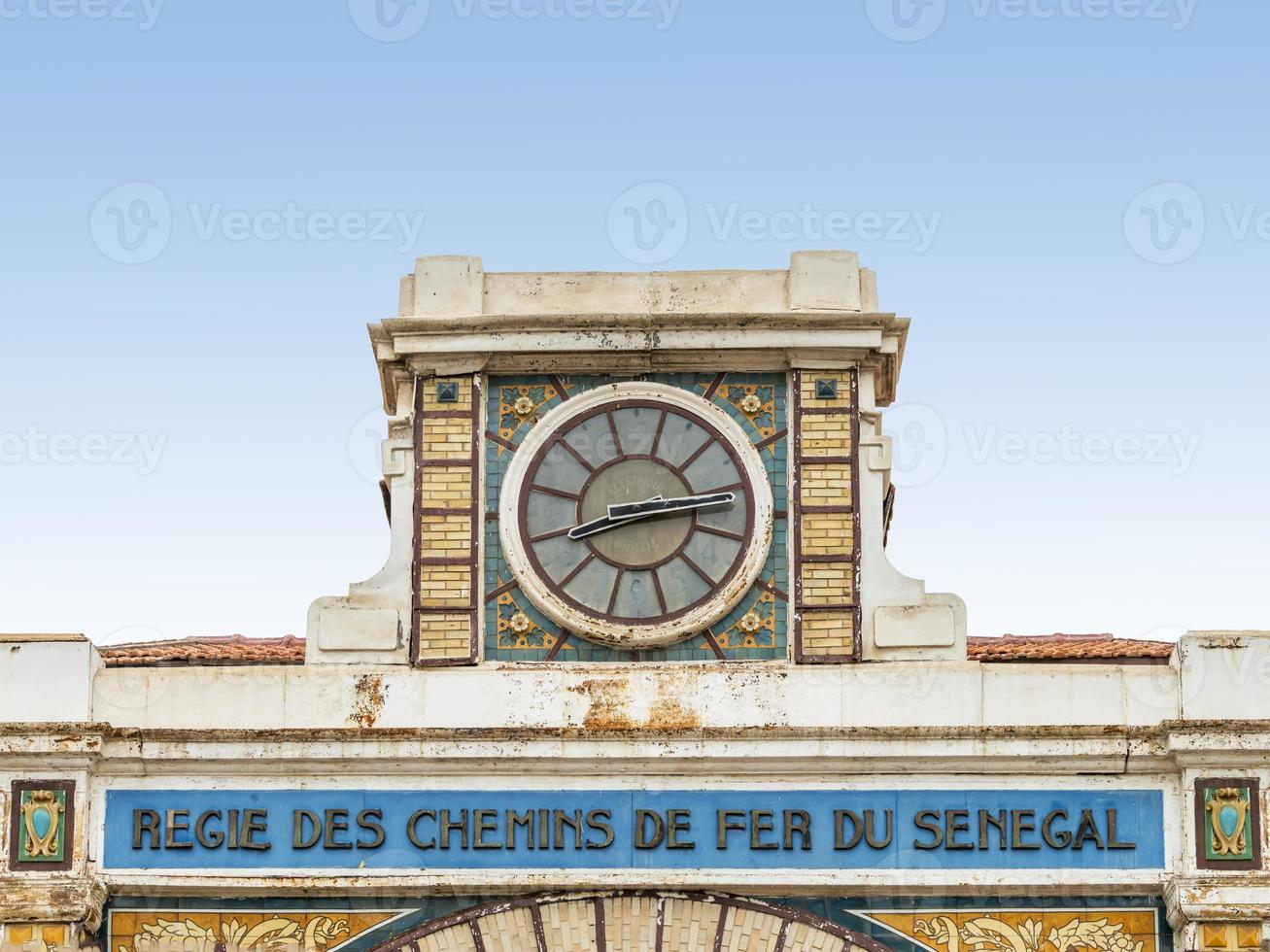 Clock, abandoned railway station of Dakar, Senegal, colonial building photo