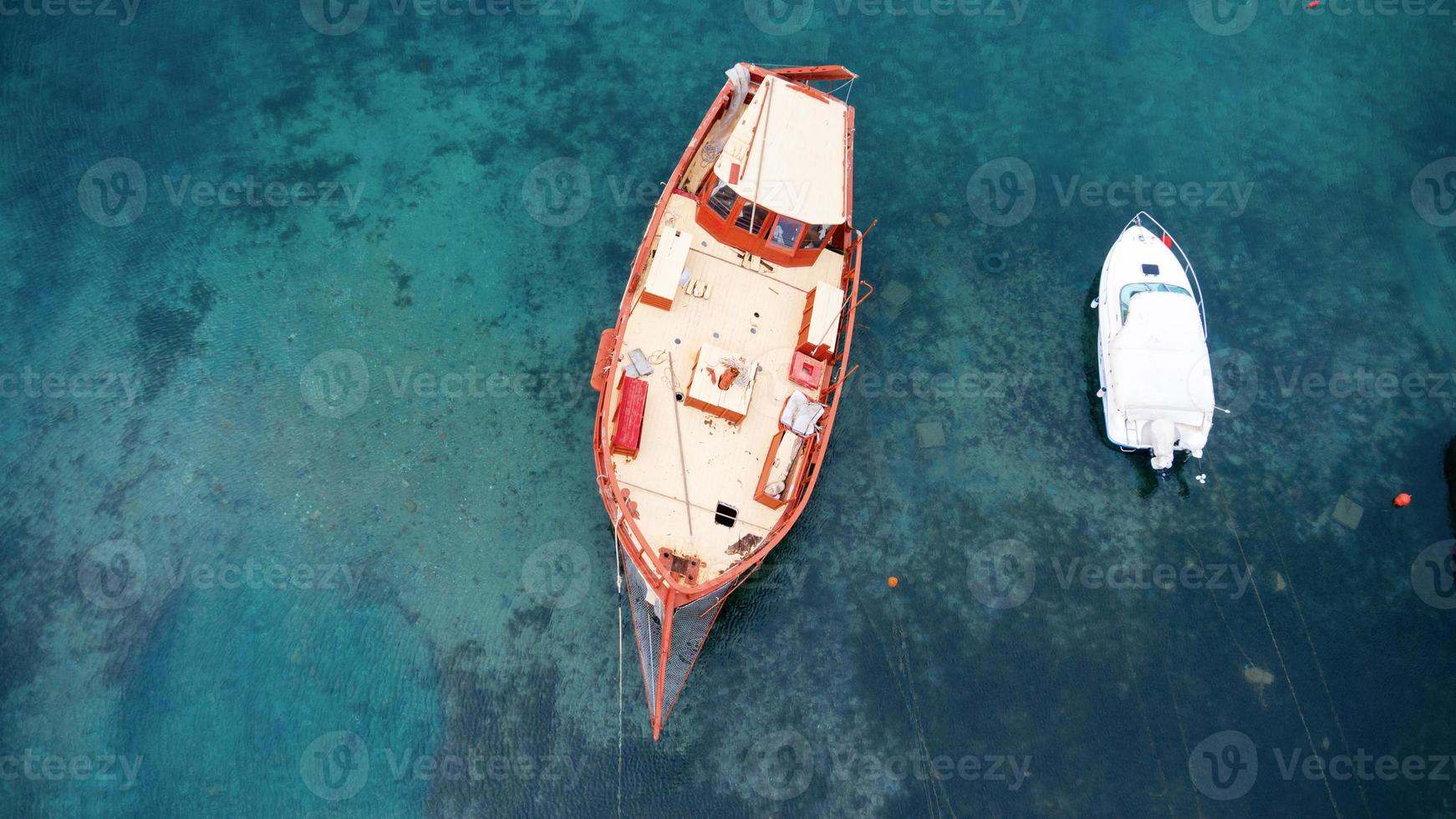 Aerial view of a wooden boat in the sea photo