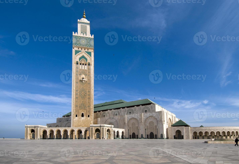 Hassan II Mosque in Casablanca, under a blue sky photo