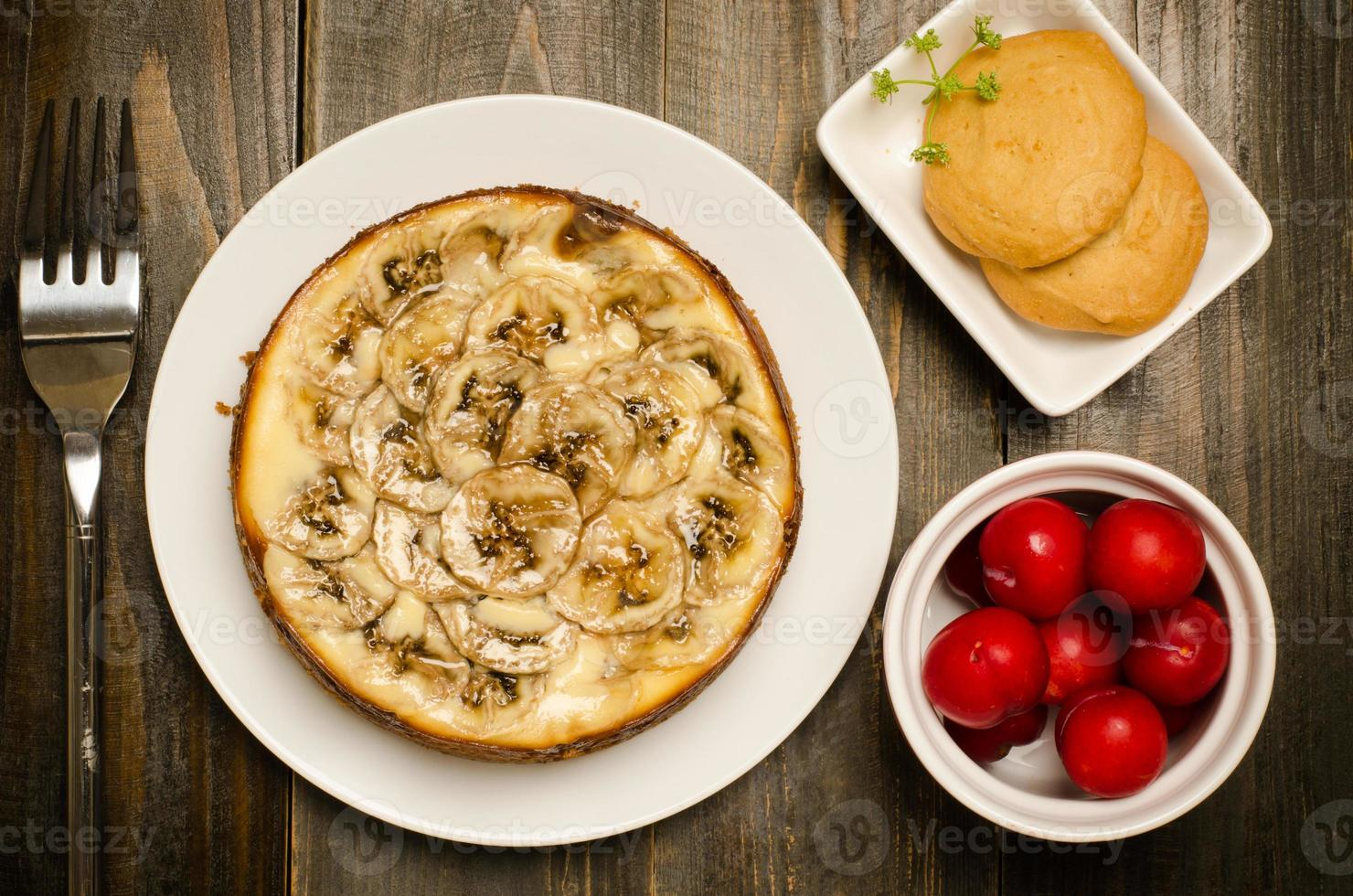 tarta de queso con plátano y caramelo foto