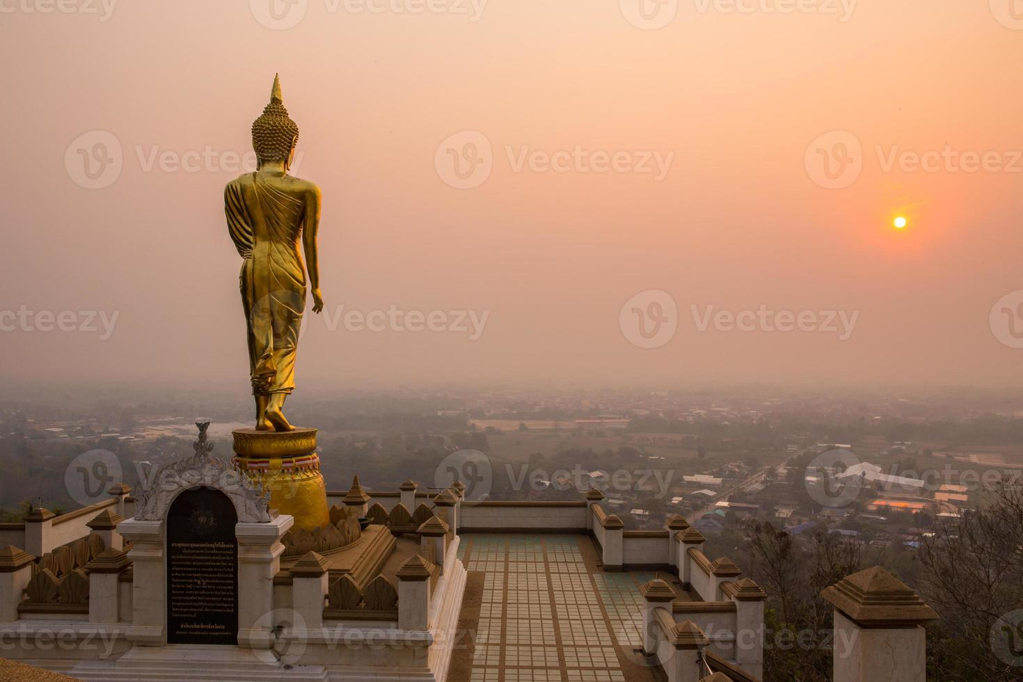 Buddha standing on a mountain Nan Province, Thailand photo