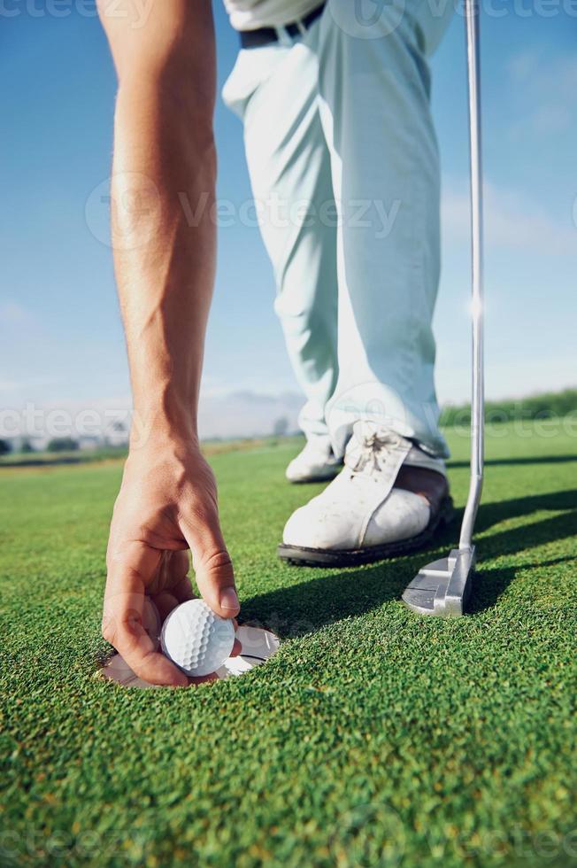 mettere l'uomo da golf foto