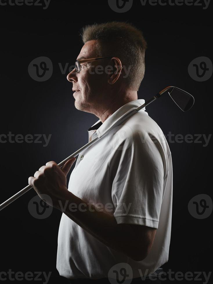 Mature man golfer and golf club photo