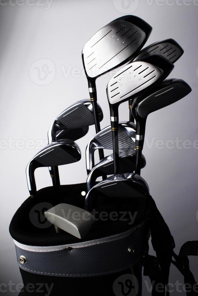 palos de golf y bolsa foto