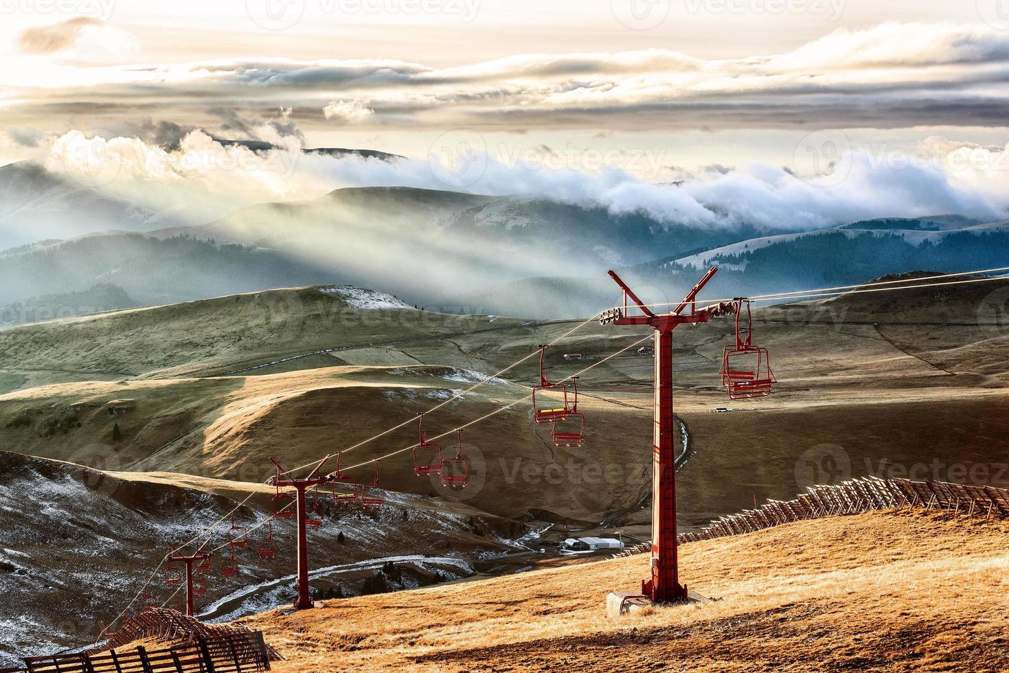 Ski lift in the mountains in sunlight photo