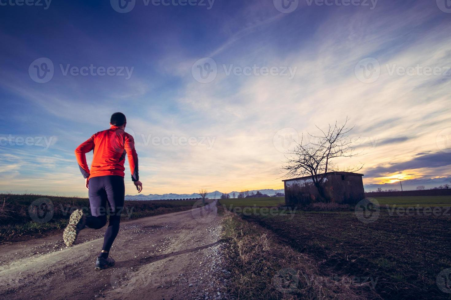 Trail running at the sunset photo