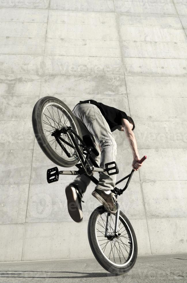 Young BMX bicycle rider photo