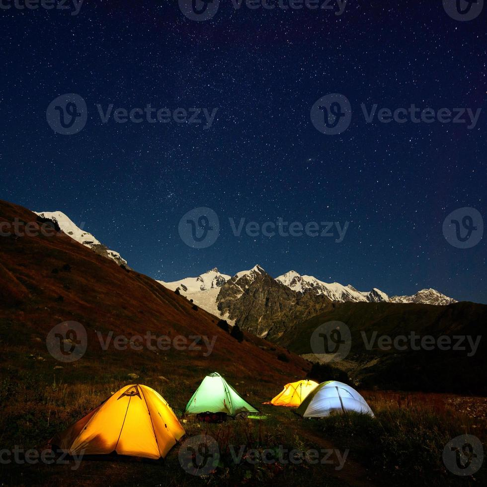 Tents in the in Caucasus valley photo