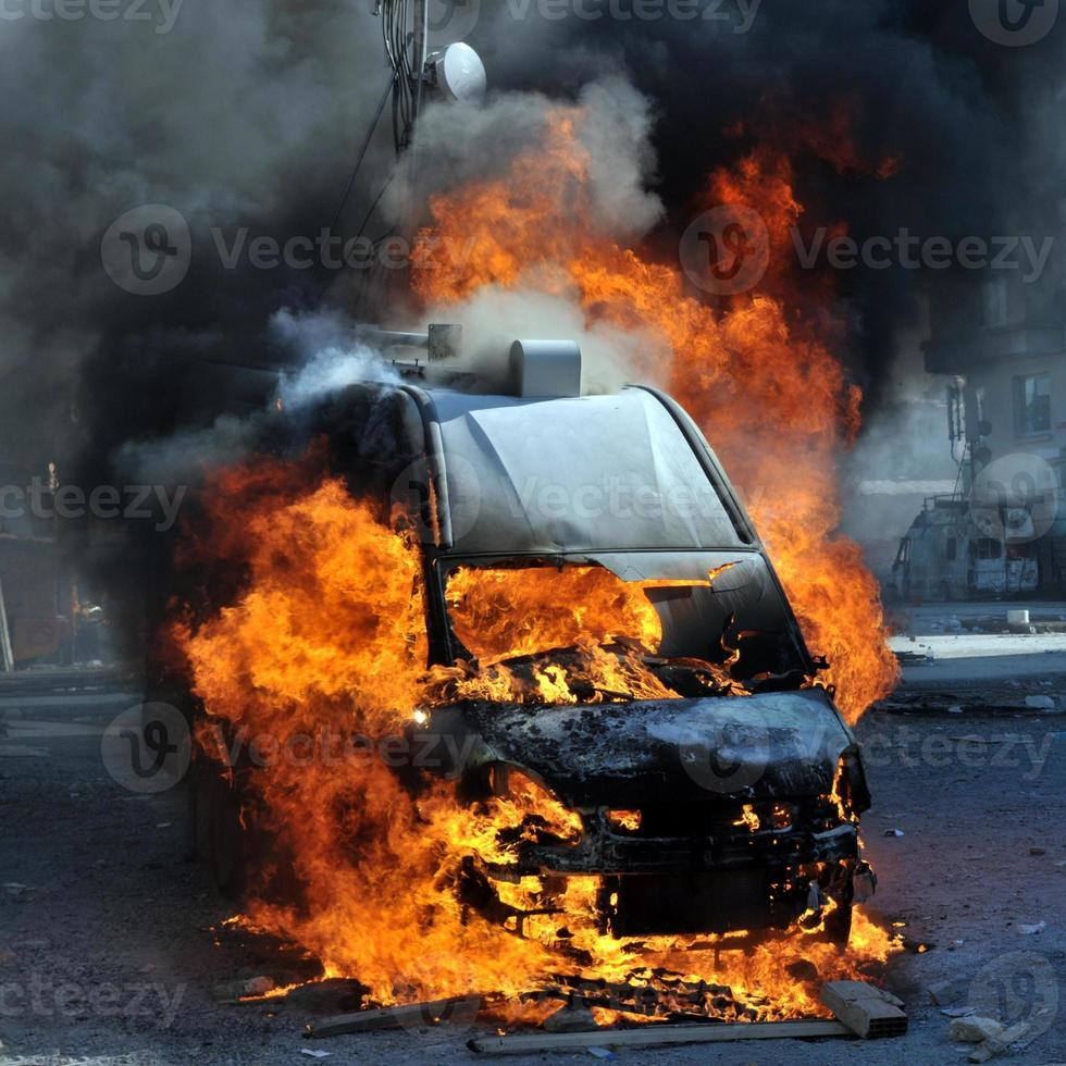 Burning van with large flames and black smoke photo