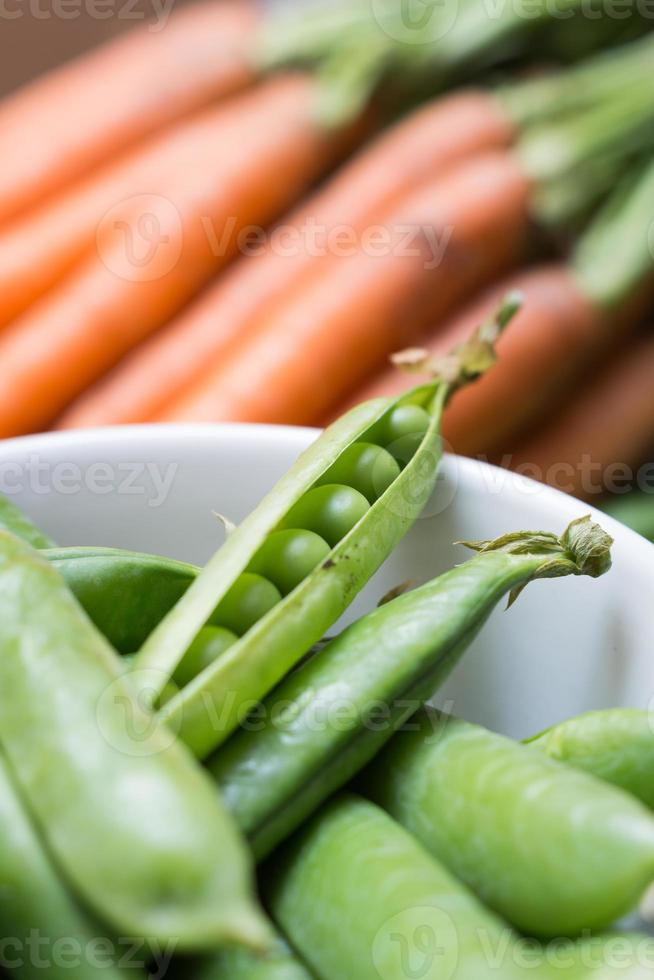 Pea pods in a bowl with carrots photo
