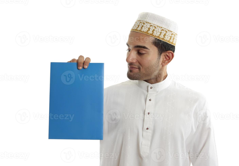 Ethnic businessman holding brochure photo