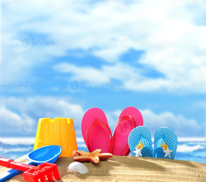 Beach accessories on sandy beach photo