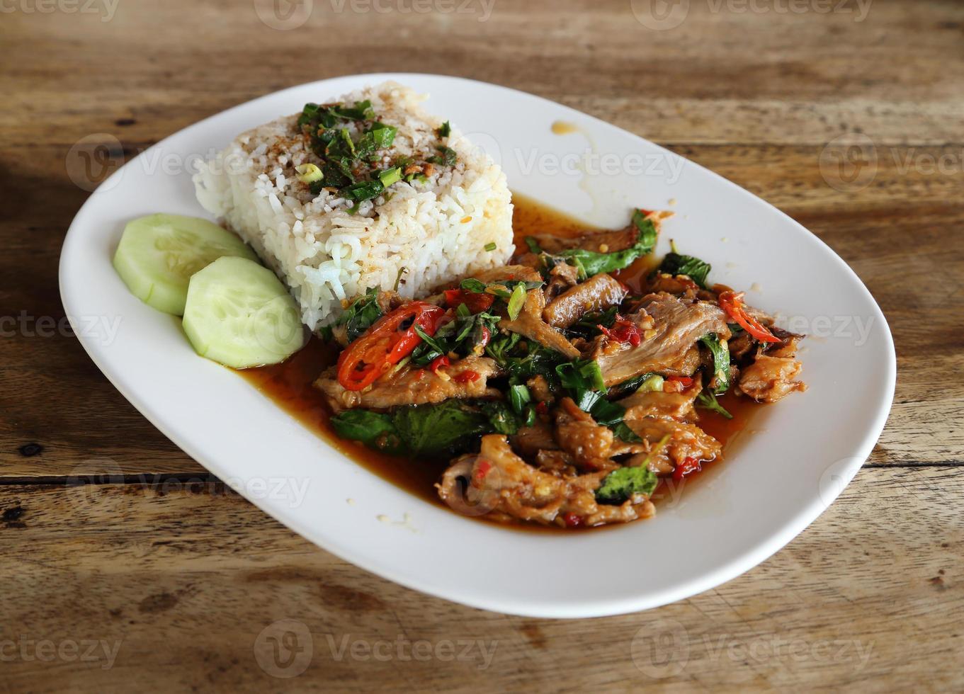 Fried pork with sweet basi and white jasmine sticky rice photo