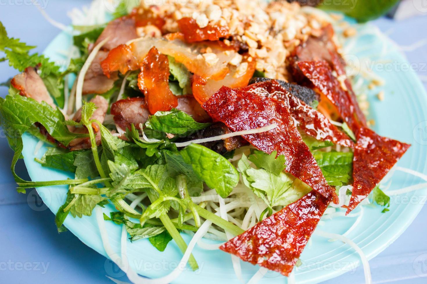 Vietnamese street food, fresh vegetable with crispy duck skin photo