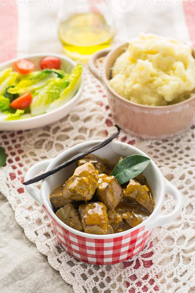 Duck filet in gravy with vanilla served with mashed potatoes photo