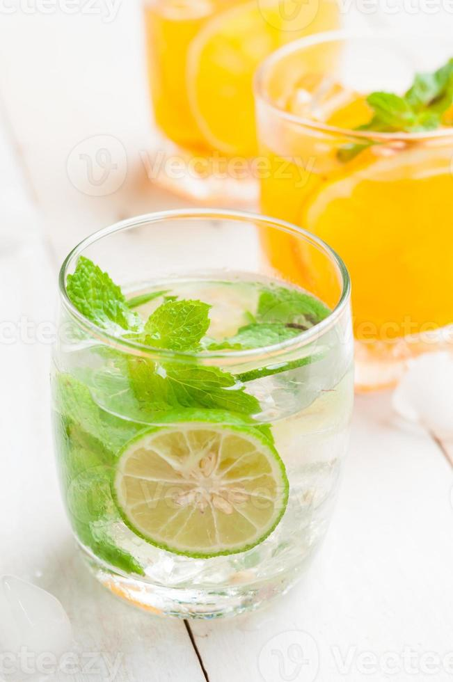 coctail of Mojito and tropical fresh juices on wooden table photo