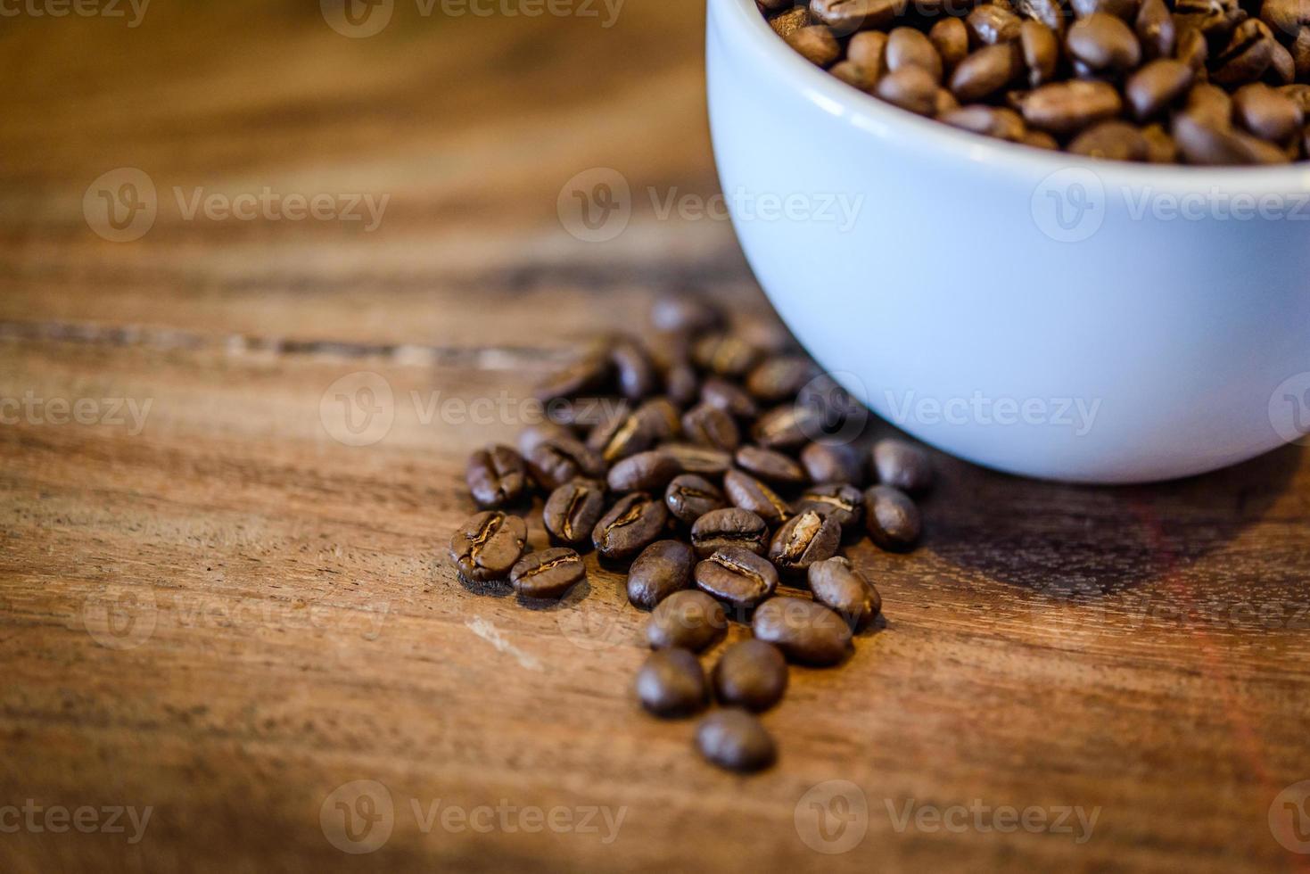 Café sobre fondo de madera grunge foto