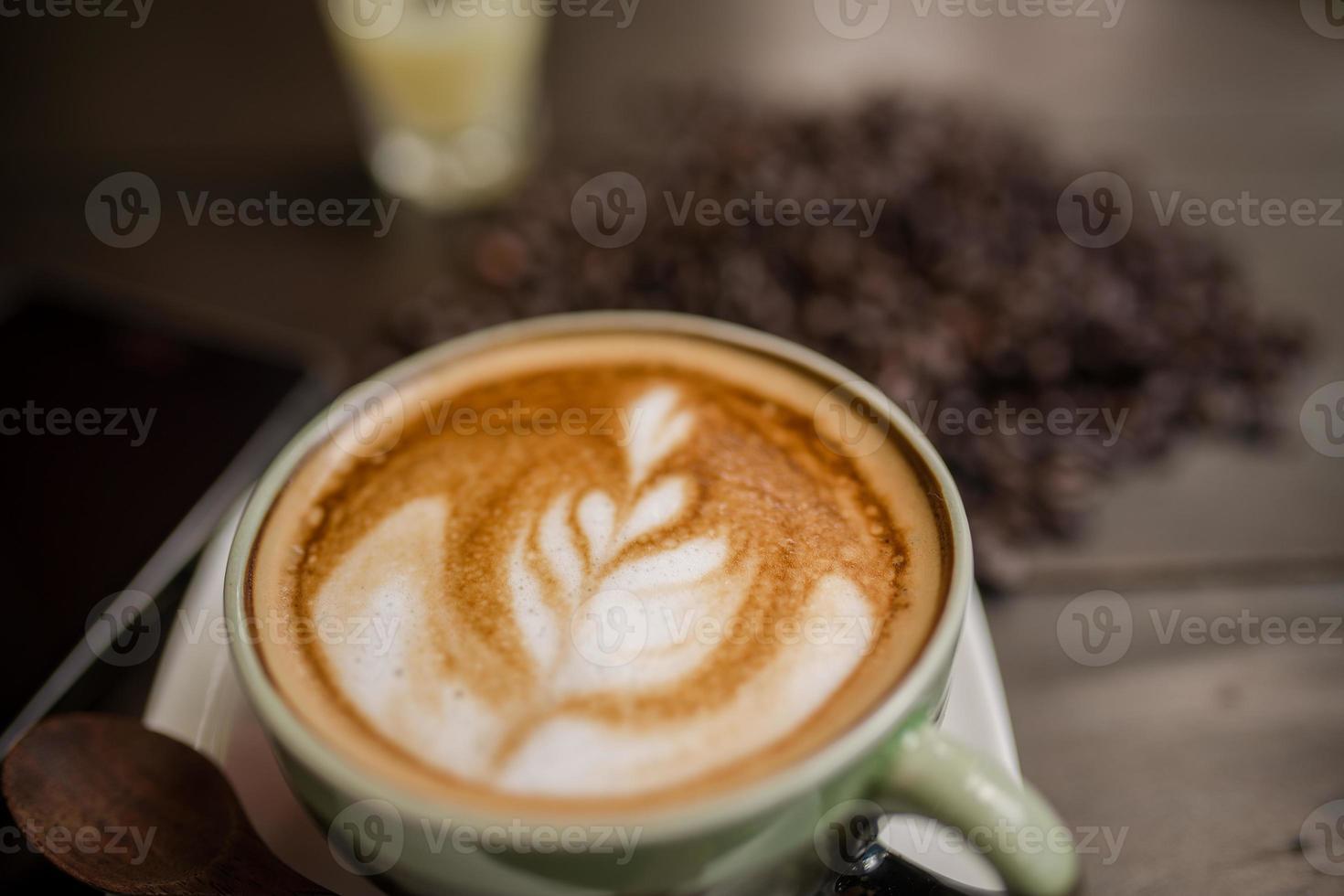 Latte Art coffee with coffee bean photo