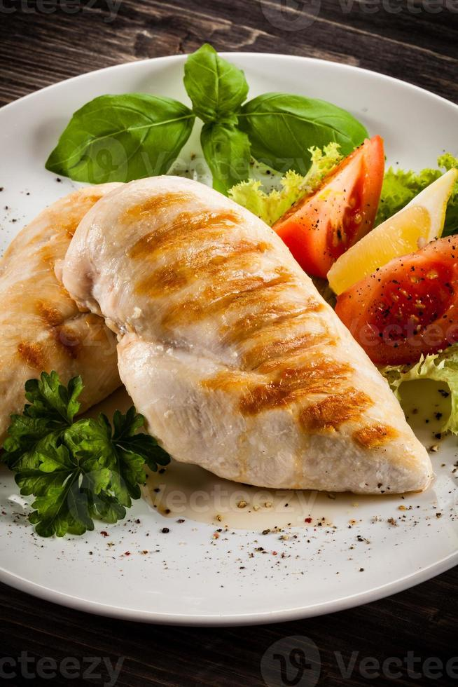 Roast chicken fillets and vegetables photo