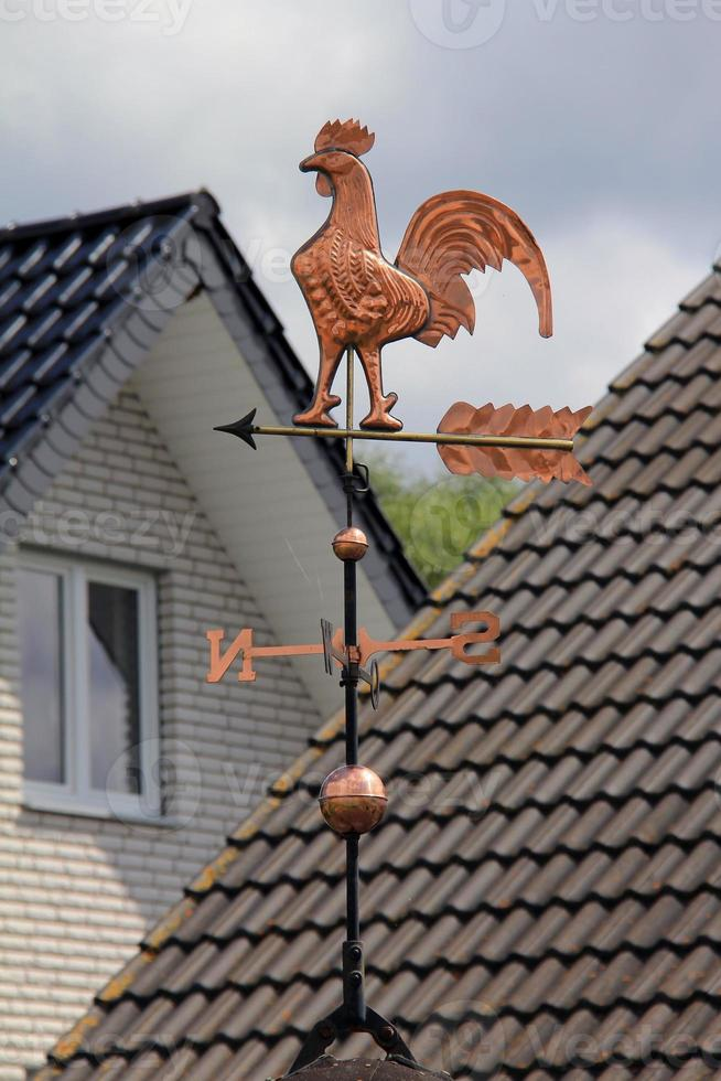 Gold Weathercock on the roof photo