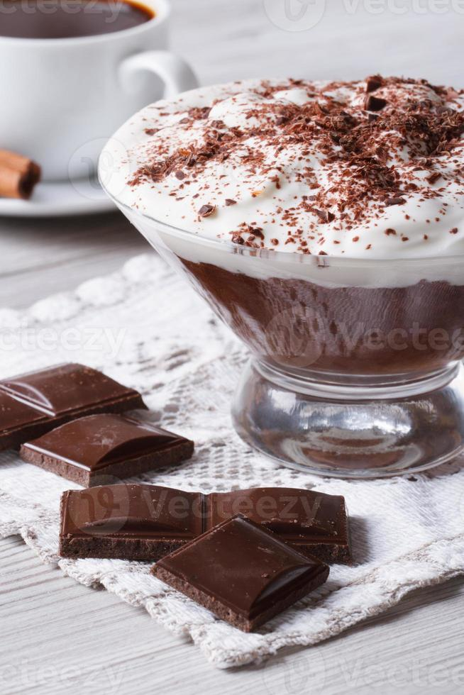 chocolate mousse with whipped cream and coffee, vertical photo