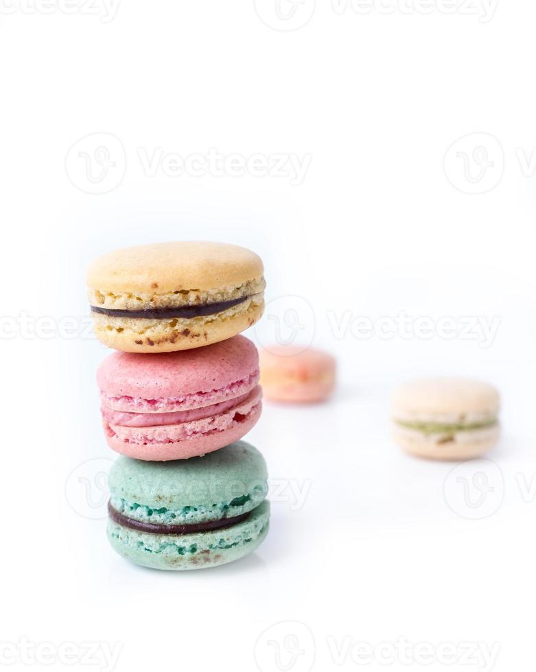 Colorful French Macarons on the white background. photo