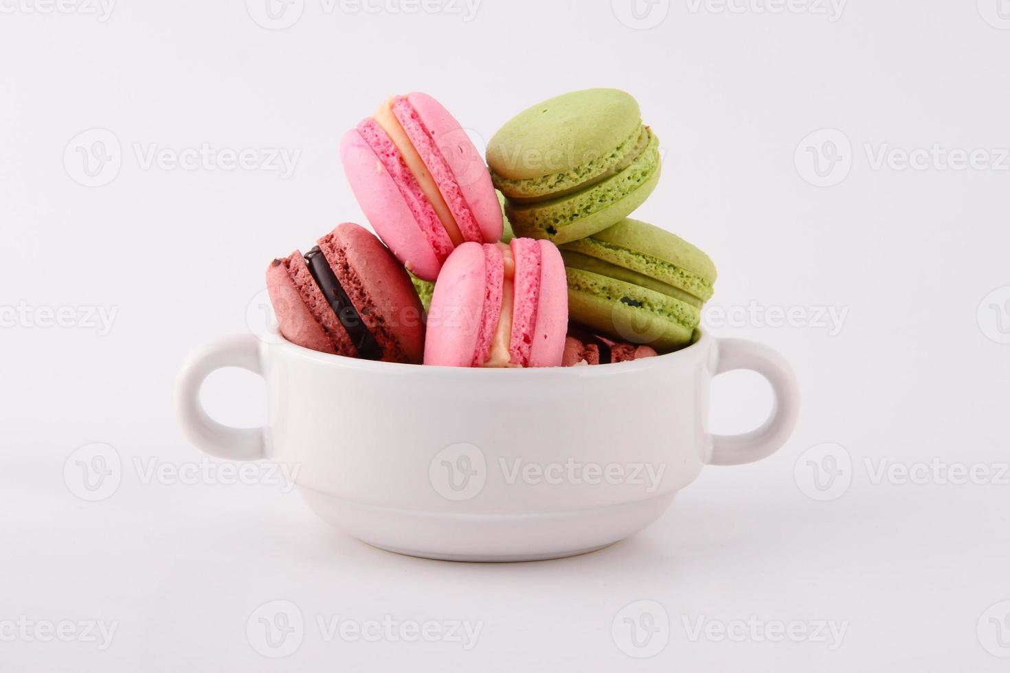 Macaron in a white bowl photo