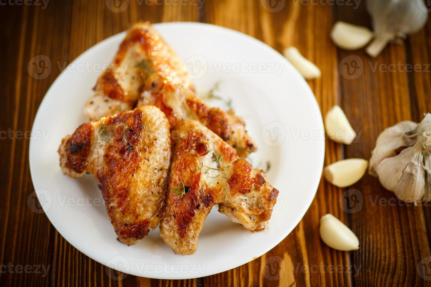 fried chicken wings with garlic photo