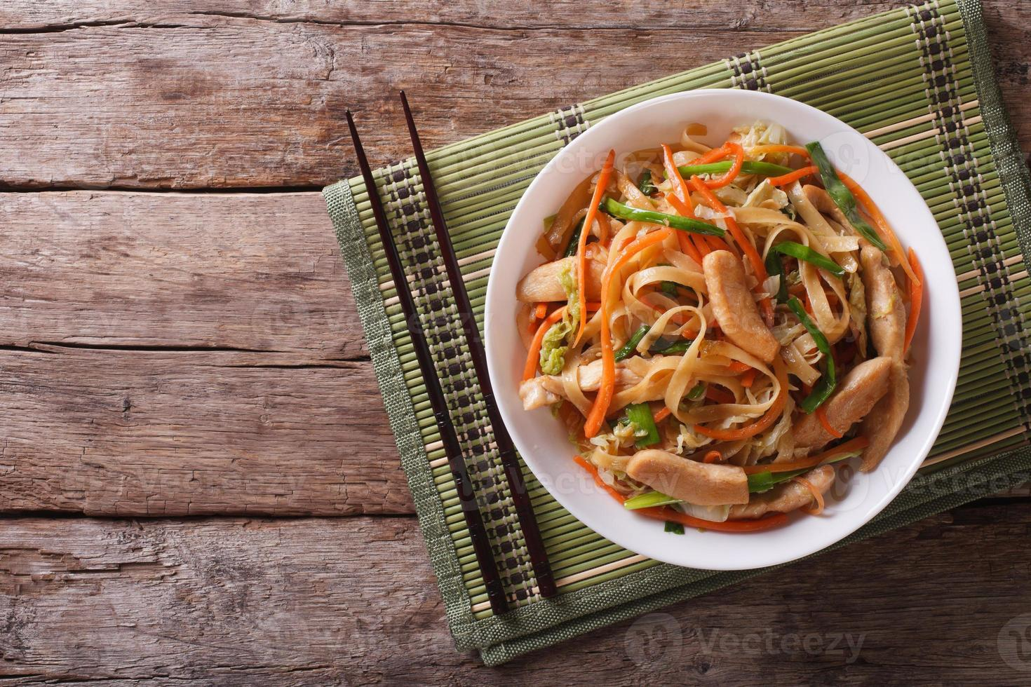 Chow Mein: fried noodles with chicken, horizontal top view photo