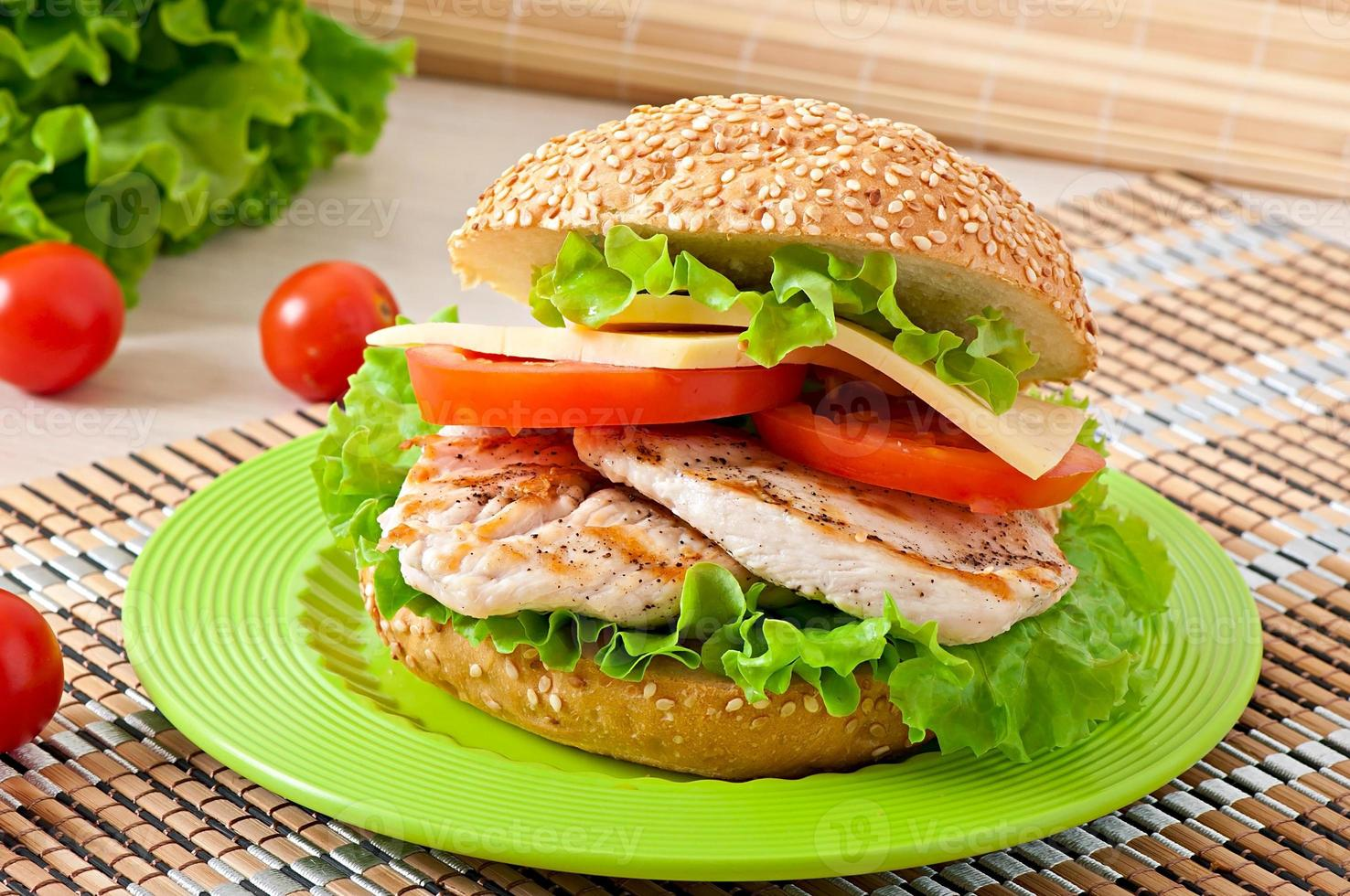 Chicken sandwich with salad and tomato photo