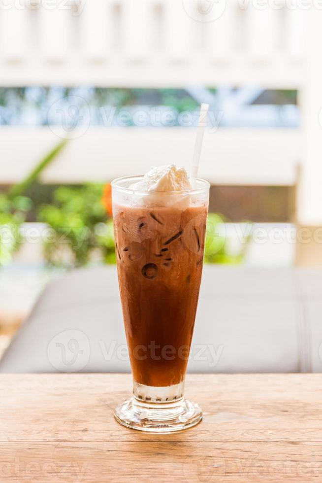 Ice coffee with whipped cream . photo
