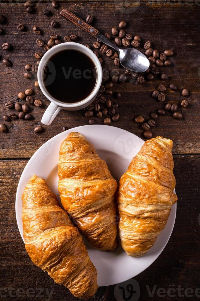 Coffee and croissant photo