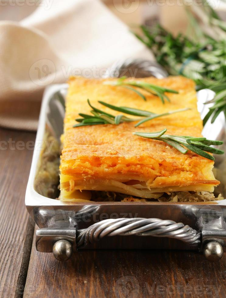homemade potato gratin with meat and cheese photo