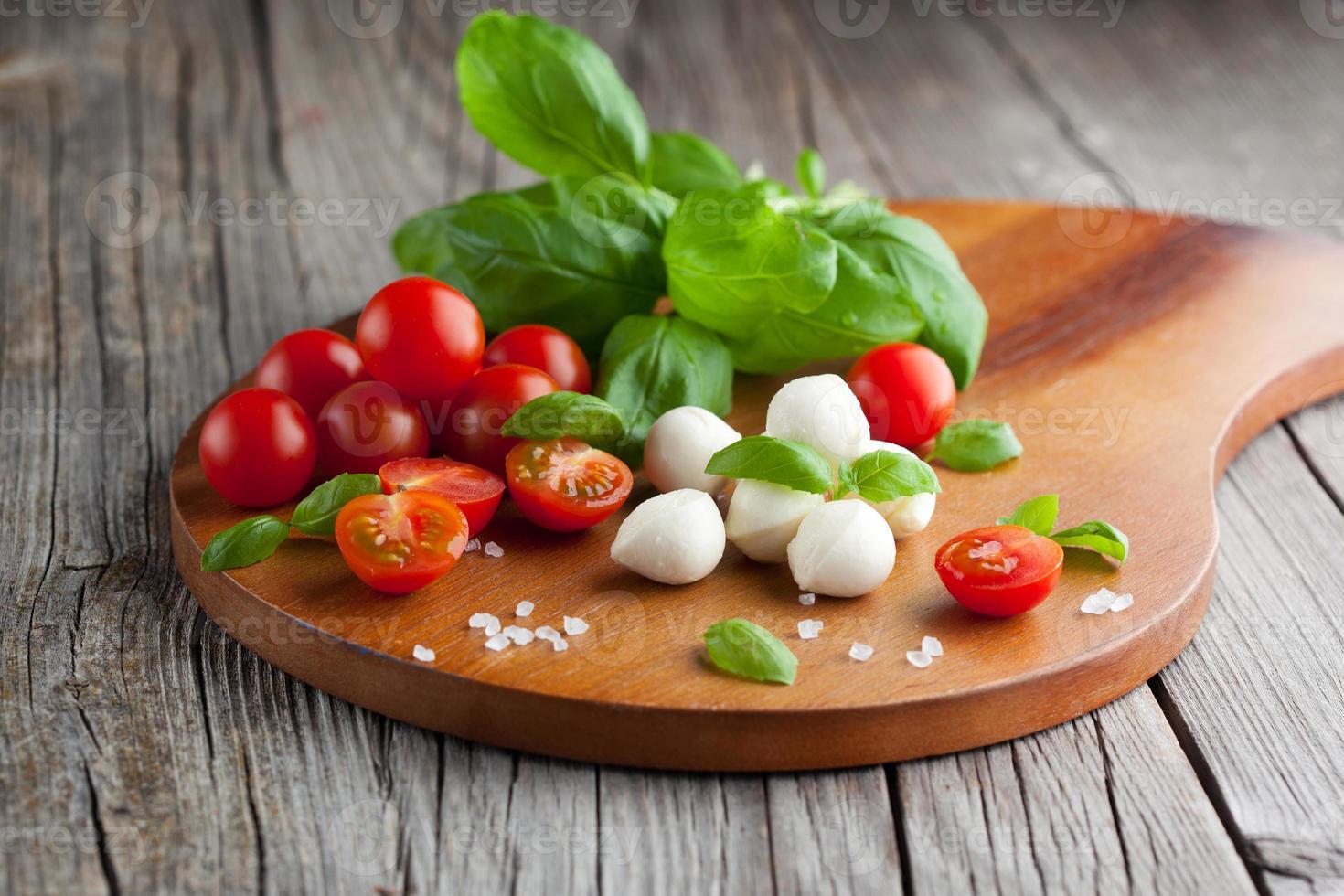 Cherry tomatoes with mozzarella photo