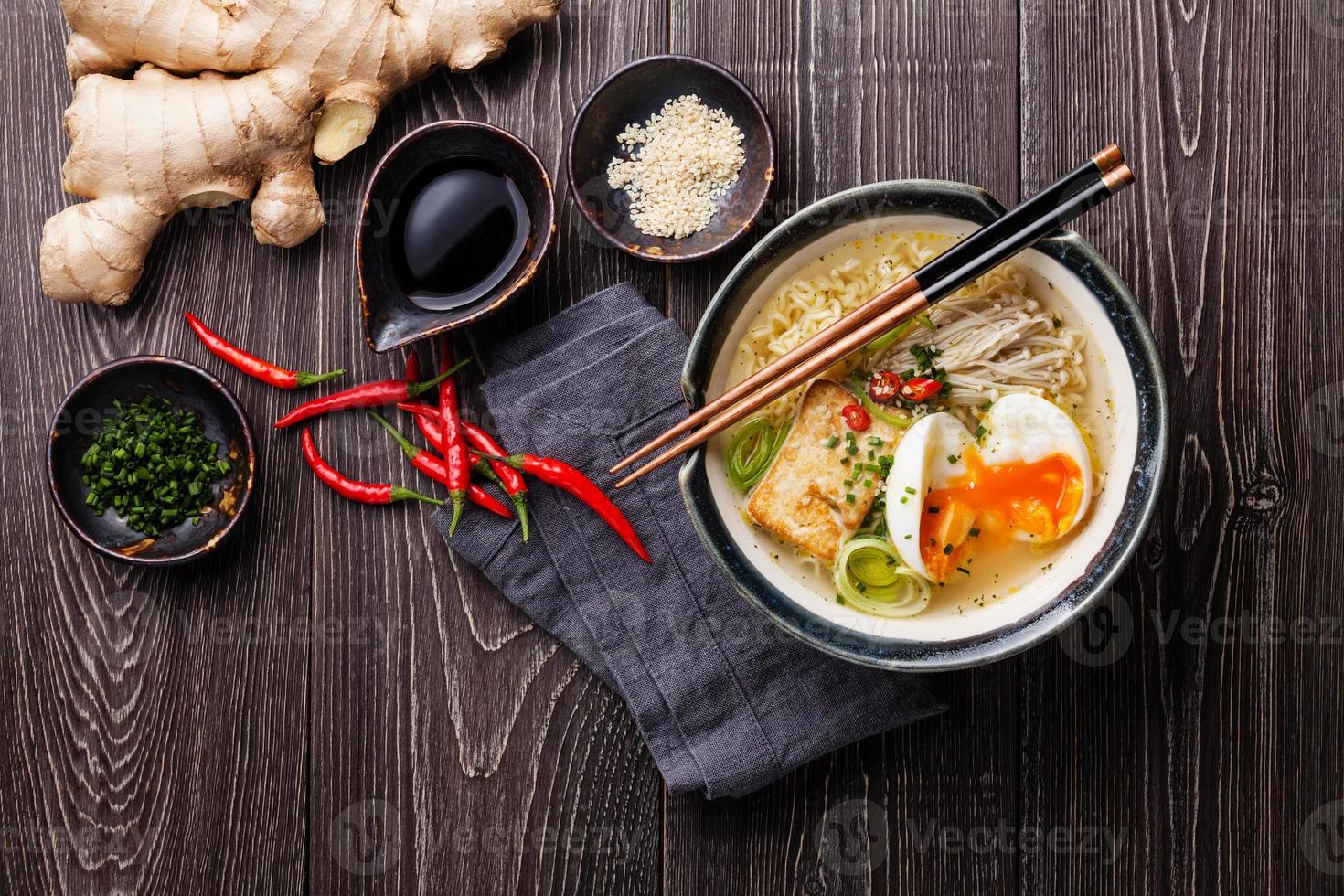 Asian Miso ramen noodles with egg, tofu and enoki photo