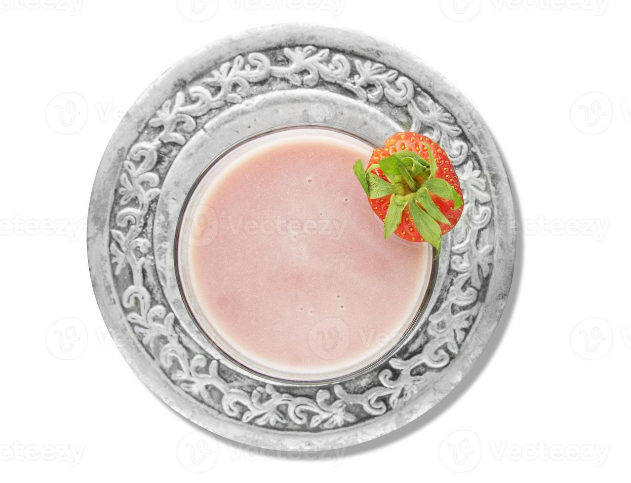 strawberry milk shake in silver plate, isolated photo