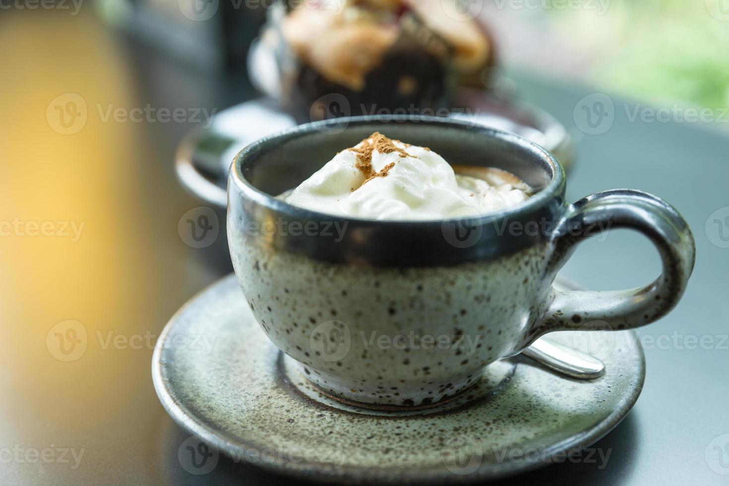 Espresso coffee with white cream photo