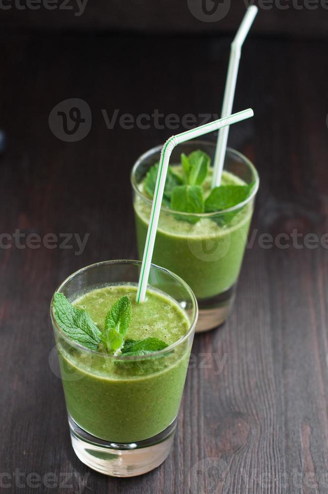 fresh homemade smoothie with spinach and bananas photo