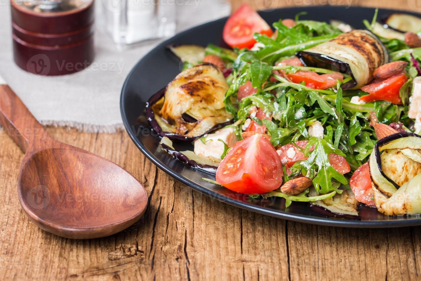 Eggplant salad with tomatoes and arugula photo