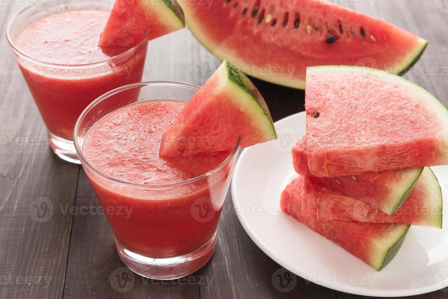 Healthy watermelon smoothie on a wood table photo