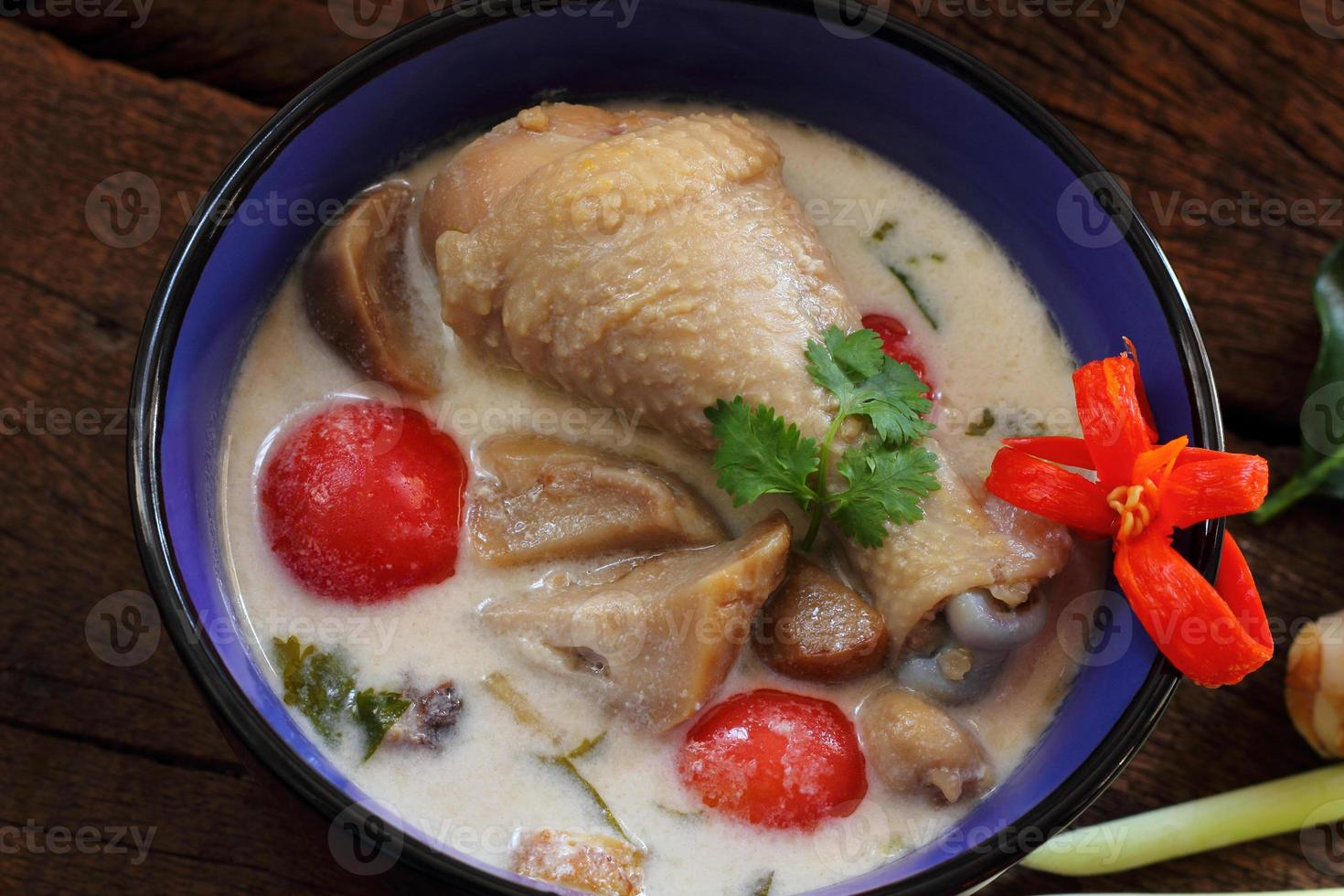 Chicken in coconut milk and galangal. photo