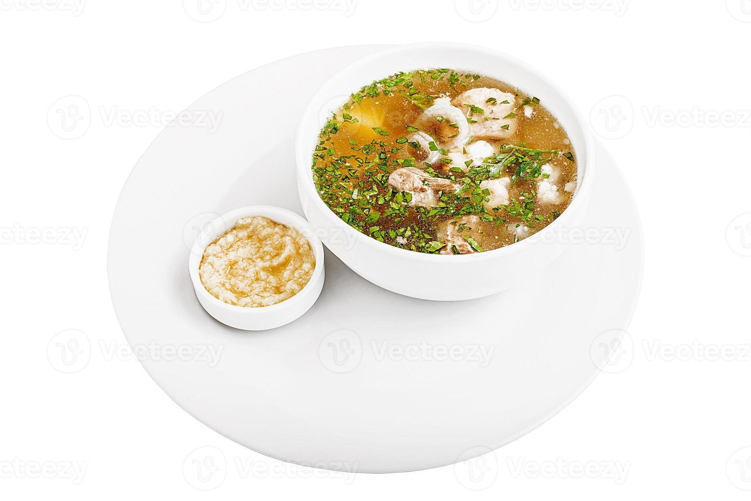 Chicken soup with sauce photo