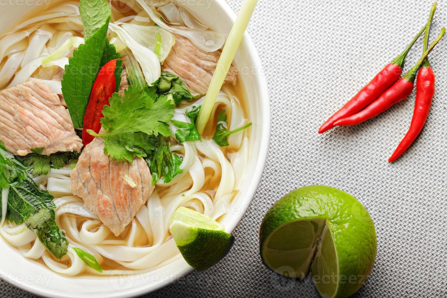 Pho bo soup above view closeup photo
