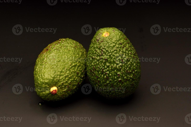 Avocado on black background photo