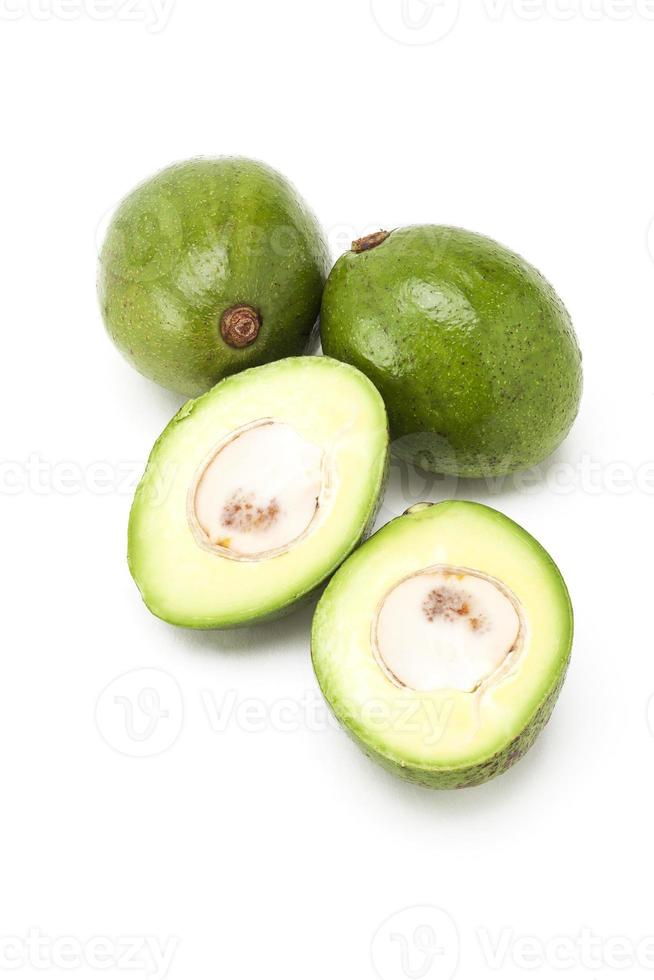 Avocados group on background photo