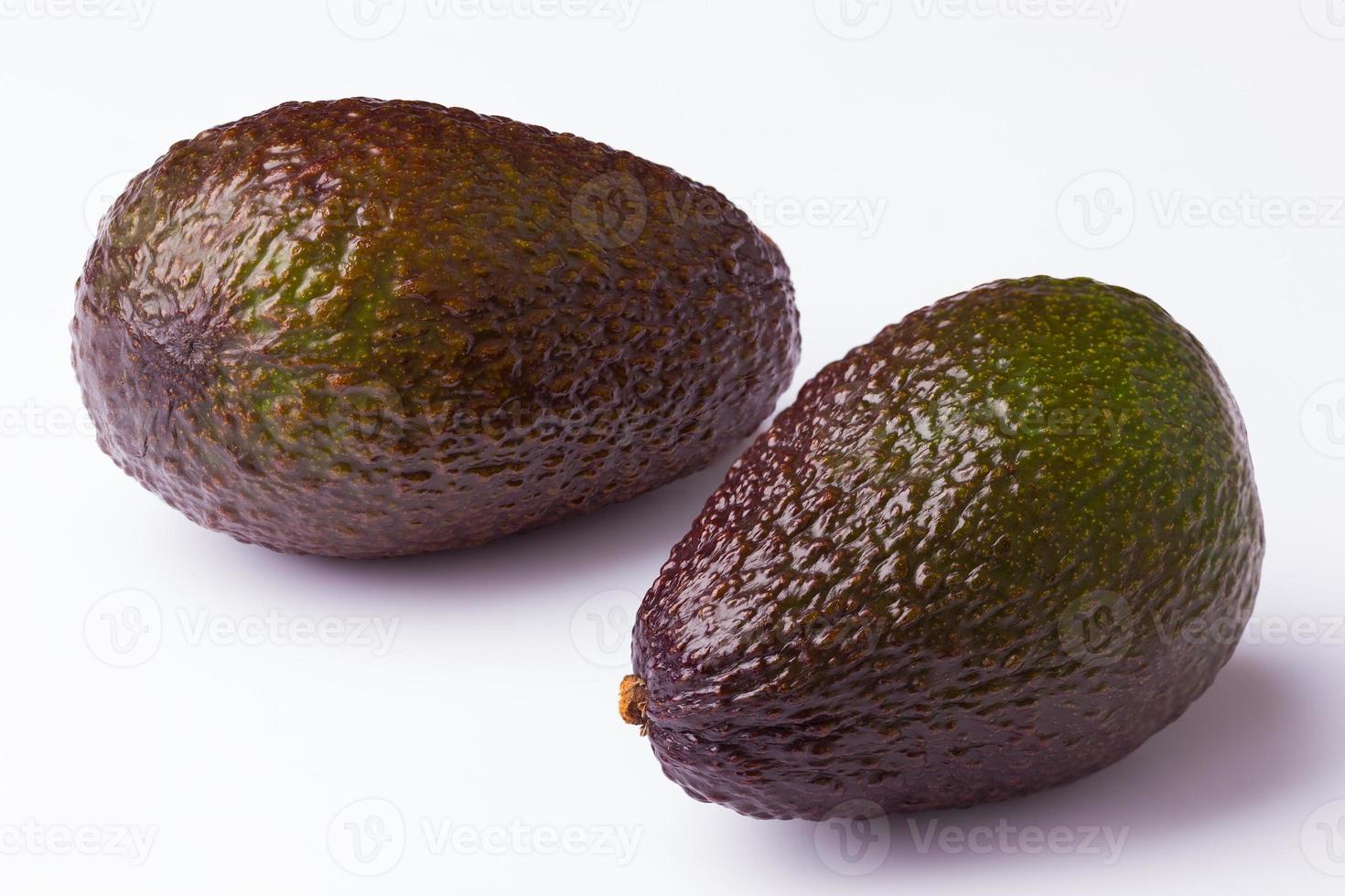 two avocados on white background photo