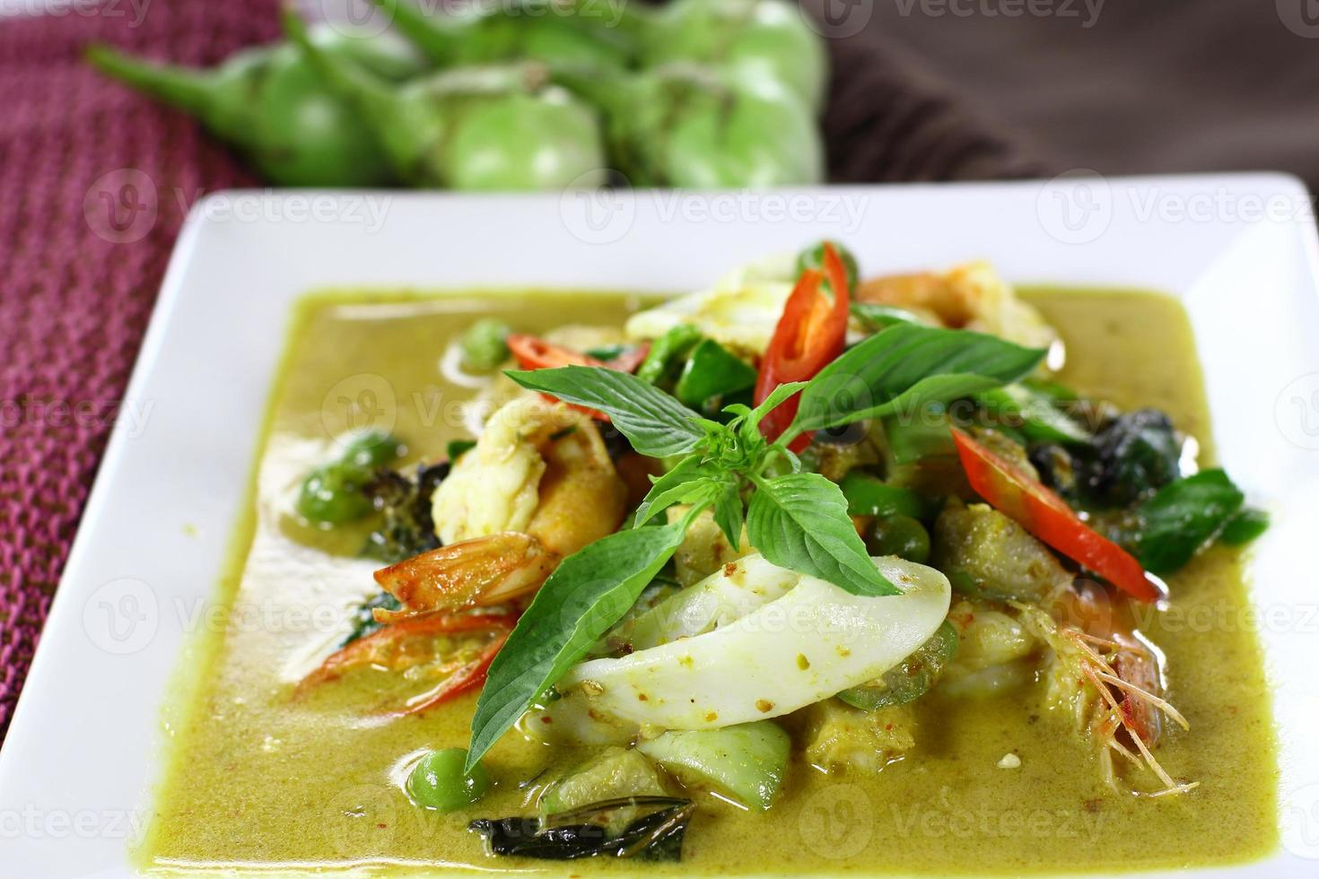 Green curry with shrimp and squid photo